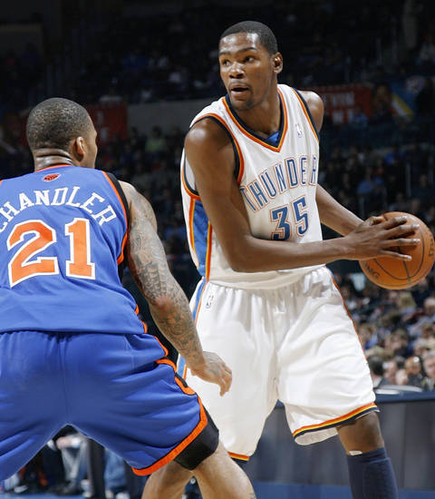 Oklahoma City's Kevin Durant (35) holds the ball as Wilson Chandler (21) of New York defends during the NBA basketball game between the Oklahoma City Thunder and the New York Knicks at the Ford Center in Oklahoma City, January 11, 2010. Photo by Nate Billings, The Oklahoman