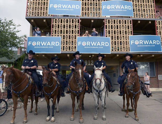 Mounted police stand guard near the Ritchie Center at the first 2012 Presidential Debate at the University of Denver, Wednesday, Oct. 3, 2012 in Denver. (AP Photo/The Denver Post, Helen H. Richardson) MAGS OUT; TV OUT; INTERNET OUT; NO SALES ORG XMIT: CODEN309