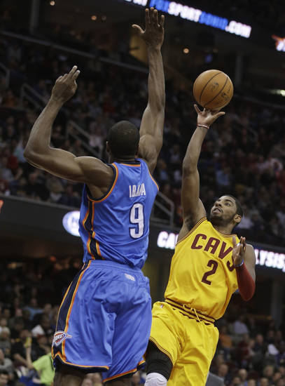 Cleveland Cavaliers' Kyrie Irving (2) shoots over Oklahoma City Thunder's Serge Ibaka (9), from the Republic of Congo, during the second quarter of an NBA basketball game on Saturday, Feb. 2, 2013, in Cleveland. (AP Photo/Tony Dejak) ORG XMIT: OHTD105