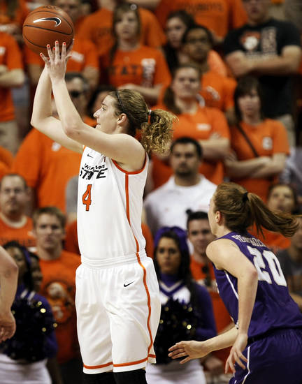 OSU's Liz Donohoe (4) takes a shot in front of James Madison's Kirby Burkholder (20) during the Women's NIT championship college basketball game between Oklahoma State University and James Madison at Gallagher-Iba Arena in Stillwater, Okla., Saturday, March 31, 2012. Photo by Nate Billings, The Oklahoman