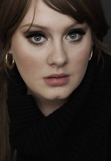 "FILE - In this Nov. 19, 2008 file photo, British singer Adele poses for a portrait in Los Angeles.  Adele's song ""Rolling In the Deep,""is  iTunes' top selling single, and her album ""21"" is the second top selling album of the week ending May 30, 2011. (AP Photo/Matt Sayles, file) ORG XMIT: NYET800"