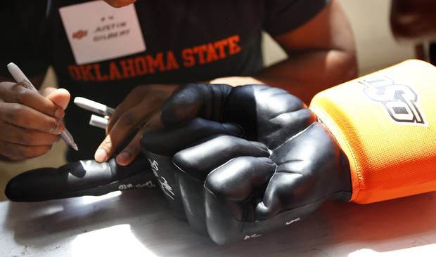 Oklahoma State football player Justin Gilbert signs an autograph during Oklahoma State's Fan Appreciation Day at Gallagher-Iba Arena in Stillwater, Okla., Saturday, Aug. 4, 2012. Photo by Sarah Phipps, The Oklahoman