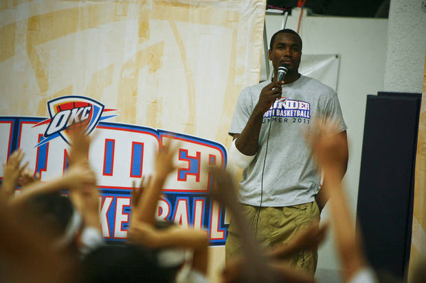 OKLAHOMA CITY THUNDER NBA BASKETBALL PLAYER / CHILD / CHILDREN / KIDS: Serge Ibaka answers questions for kids at the Thunder Youth Basketball Camp at the Santa Fe Family Life Center on Tuesday, June 14, 2011. Photo by Zach Gray, The Oklahoman ORG XMIT: KOD