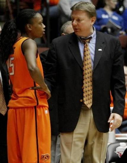 OSU coach Kurt Budke talks with OSU's Toni Young (15) during the women's college basketball Big 12 Championship tournament game between Oklahoma State and Texas Tech in Kansas City, Mo., Tuesday, March 8, 2011. Photo by Bryan Terry