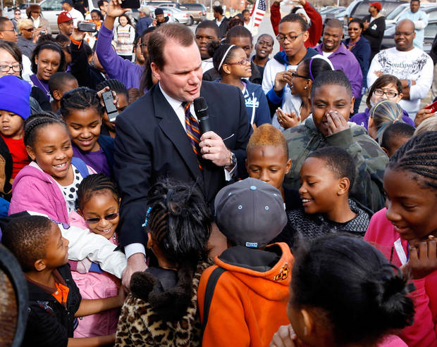Lt. Gov. Todd Lamb is surrounded by children as they pull on a rope to ring a replica Liberty Bell in front of the Oklahoma History Center; it is one of several events in the Oklahoma City area that allowed local residents to observe the national holiday honoring slain civil rights leader, Dr. Rev. Martin Luther King, Jr. on Monday, Jan. 16,  2012,    Photo by Jim Beckel, The Oklahoman