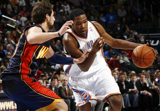 Oklahoma City's Kevin Durant drives the ball past Marco Belinelli of Golden State in the second half during the NBA basketball game between the Golden State Warriors and the Oklahoma City Thunder at the Ford Center in Oklahoma City, Monday, December 8, 2008. Golden State won, 112-102.  BY NATE BILLINGS, THE OKLAHOMAN