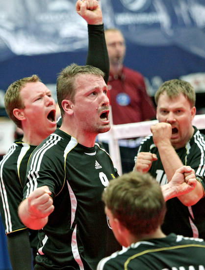 German players Christoph Herzog, Jurgen Schrapp and Benjamin Oesch (from left to right) celebrate a point against Russia during the fourth day of competition at the World Sitting Volleyball championships on the University of Central Oklahoma campus in Edmond, Okla., on Wednesday, July 14, 2010. Photo by John Clanton, The Oklahoman