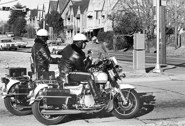 Two Oklahoma City police officers watch for speeders on N Robinson near NW 32 in this 1981 photo. <strong>DAVID McDANIEL - The Oklahoman archives</strong>