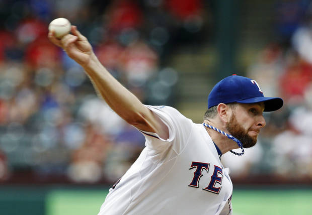 Texas Rangers starting pitcher Scott Feldman delivers to the Minnesota Twins in the first inning of a baseball game, Sunday, Aug. 26, 2012, in Arlington, Texas. (AP Photo/Tony Gutierrez)