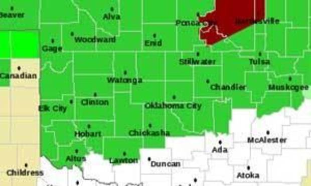 Red indicates flash flood warning.  Green indicates flash flood watch. Map provided by National Weather Service, Norman.
