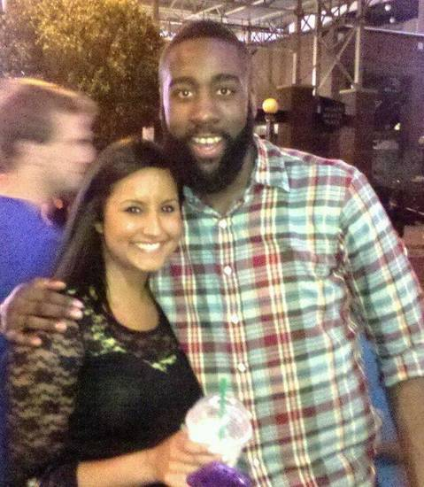 Layna Austin, 23, from Checotah, catches Thunder games via Slingbox, a TV streaming media device that�s connected to DirecTV stateside. From Russia, that means games are bright and early, at 7 a.m., she said. Here, she poses with James Harden, a favorite player. Photo provided