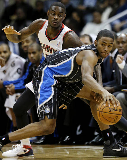 Orlando Magic's Moe Harkless, right, dribbles the ball away from Atlanta Hawks' Anthony Morrow in the first quarter of an NBA basketball game, Monday, Nov. 19, 2012, in Atlanta. (AP Photo/David Goldman)