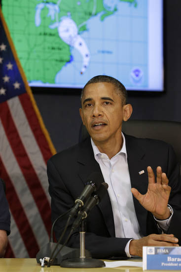 <p>With a map of the projected path of Hurricane Sandy behind him, President Barack Obama speaks to the media at Federal Emergency Management Agency headquarters in Washington, on Sunday, Oct. 28, 2012. FEMA is coordinating the deployment of federal resources in preparation for Hurricane Sandy. (AP Photo/Jacquelyn Martin)</p>