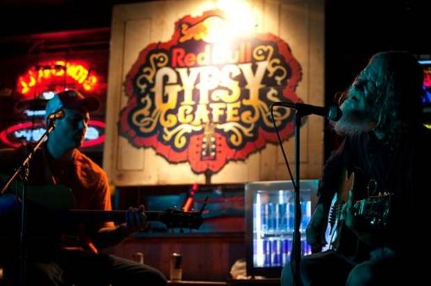 Musicians Mike McClure and Randy Crouch play together April 15 at the Stonewall Tavern in Stillwater. Several musicians reunited in Stillwater last month for the filming of a Red Bull mini-documentary about red dirt music. (Red Bull photo by Kelly Kerr)