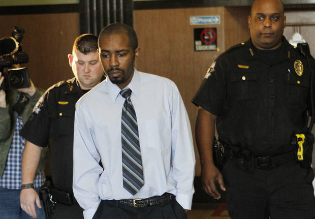 Christopher Travis Baker is led from the courtroom at the Oklahoma County Courthouse in Oklahoma City, Thursday December 06, 2012. Photo By Steve Gooch, The Oklahoman