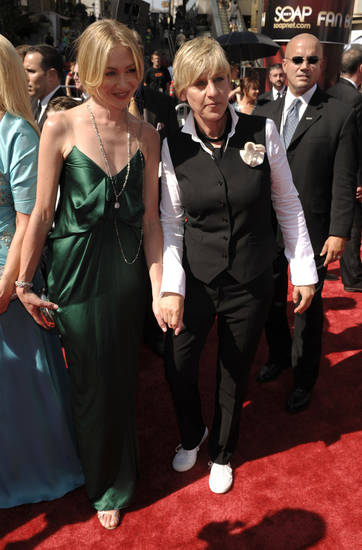 Ellen DeGeneres and Portia de Rossi, left, arrive at the Daytime Emmy Awards on Friday June 20, 2008 in Los Angeles. (AP Photo/Chris Pizzello) ORG XMIT: CADC123