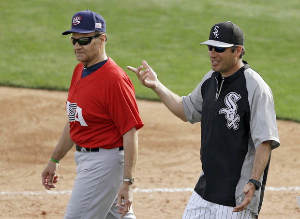Chicago White Sox manager Robin Ventura, right, walks with United States manager Joe Torre after a 4-4 tie in an exhibition baseball game, Tuesday, March 5, 2013, in Glendale, Ariz. (AP Photo/Mark Duncan) ORG XMIT: AZMD122