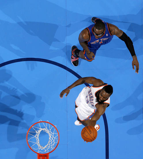 Oklahoma City's James Harden (13) goes past New York's Amar'e Stoudemire (1) during the NBA game between the Oklahoma City Thunder and the New York Knicks at Chesapeake Energy Arena in Oklahoma CIty, Saturday, Jan. 14, 2012. Photo by Bryan Terry, The Oklahoman