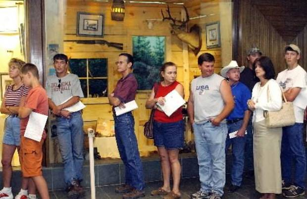 Oklahoma City, Monday, 6/30/2003:  LICENSE, FEE HIKE: People holding applications wait in line in the Department of Wildlife Building Monday, A large crowd filled the lobby during the lunch hour to obtain  hunting and fishing  licenses before the fee increase goes into effect tomorrow. Staff photo by Jim Beckel.