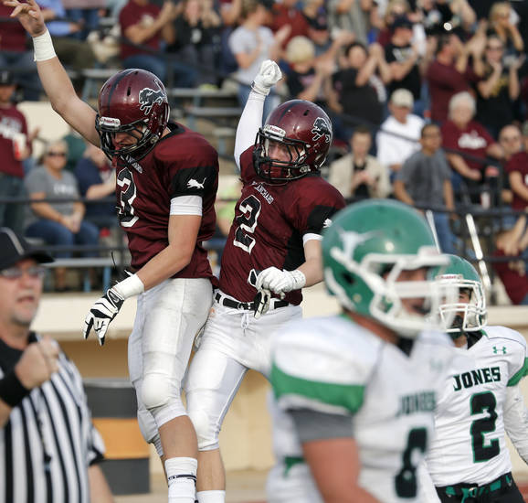 Blanchard's Zach Hill (3) and Tanner Foster (2) celebrate during the high school playoff game between Jones and Blanchard at Putnam City High School,  Saturday,Dec. 1, 2012. Photo by Sarah Phipps, The Oklahoman