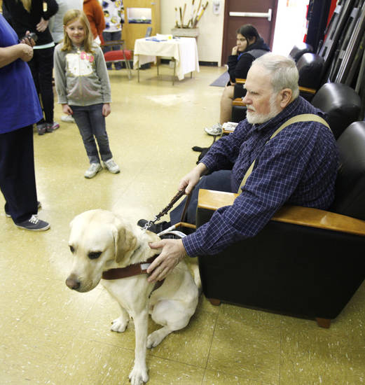 Ralph Haney, president of the Oklahoma Guide Dogs Alumni Association, talks about his guide dog, Tallis, with Dacia Sims, 9, at Martin Park Nature Center in Oklahoma City. Photos by Paul Hellstern, The Oklahoman