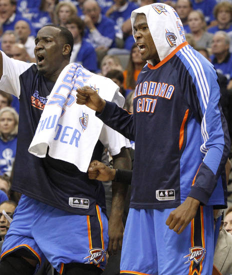 Oklahoma City's Kendrick Perkins and Kevin Durant react during game 2 of the Western Conference Finals in the NBA basketball playoffs between the Dallas Mavericks and the Oklahoma City Thunder at American Airlines Center in Dallas, Thursday, May 19, 2011. Photo by Bryan Terry, The Oklahoman