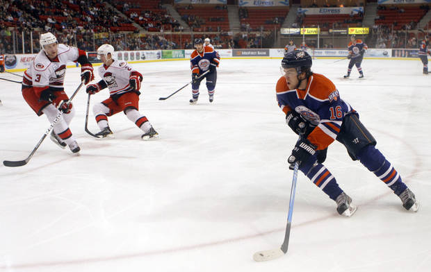 Oklahoma City's Magnus Paajarvi skates  to the goal during the AHL game between the Oklahoma City Barons and the Charlotte Checkers at the Cox Convention Center in Oklahoma City, Friday, Feb. 3, 2012. Photo by Sarah Phipps, The Oklahoman ORG XMIT: KOD