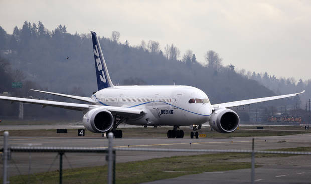 A Boeing 787 jet returns after a test flight in February at Boeing Field in Seattle. Boeing�s 787 Dreamliners will be able to resume flights under a notice expected to be issued next week by the Federal Aviation Administration. AP FILE Photo