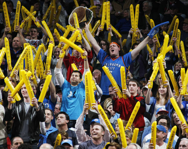 Thunder fans cheer during a Dallas foul shot in the NBA basketball game between the Dallas Mavericks and the Oklahoma City Thunder at the Oklahoma City Arena in Oklahoma City, Monday, Dec. 27, 2010. Dallas won, 103-93. Photo by Nate Billings, The Oklahoman
