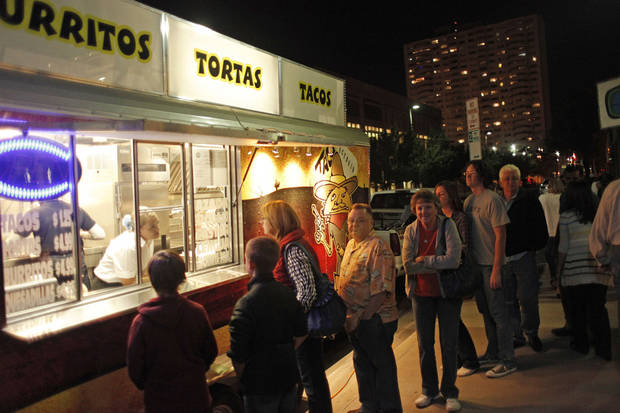 People gather at a food truck along N Hudson Avenue at 8th Street for last year's  H&8th street market event. Photo by Doug Hoke, The Oklahoman Archives <strong>Doug Hoke - THE OKLAHOMAN</strong>