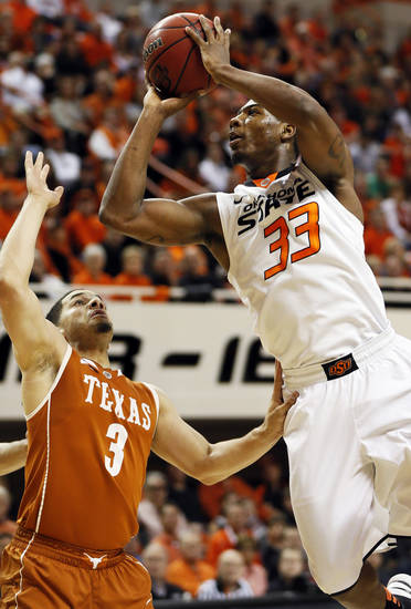 Oklahoma State's Marcus Smart (33) shoots against Javan Felix (3) during a men's college basketball game between Oklahoma State University (OSU) and the University of Texas at Gallagher-Iba Arena in Stillwater, Okla., Saturday, March 2, 2013. Photo by Nate Billings, The Oklahoman