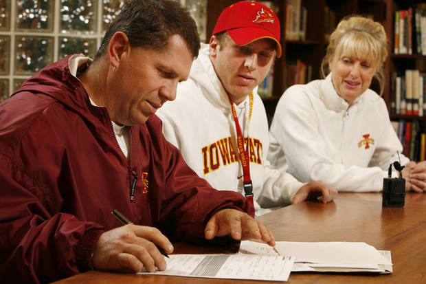 Beau Blankenship's father Charlie signs his part of a letter of intent for Beau to play college football at Iowa State University as mother Cynthia watches at Norman North High School in  Norman, Okla. on Wednesday, Feb. 4, 2009.    Photo by Steve Sisney, The Oklahoman