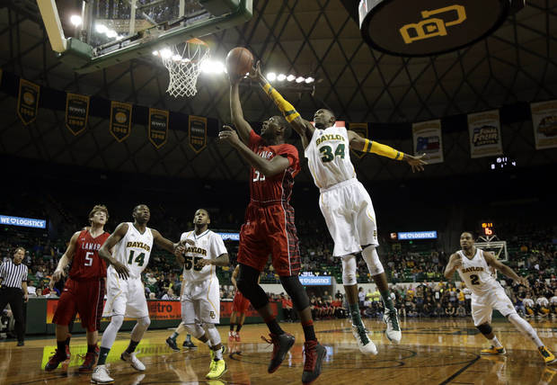 Lamar forward Stan Brown, center left, has his shot blocked by Baylor forward Cory Jefferson (34) in the first half of an NCAA college basketball game on Wednesday, Dec. 12, 2012, in Waco, Texas. (AP Photo/Tony Gutierrez)