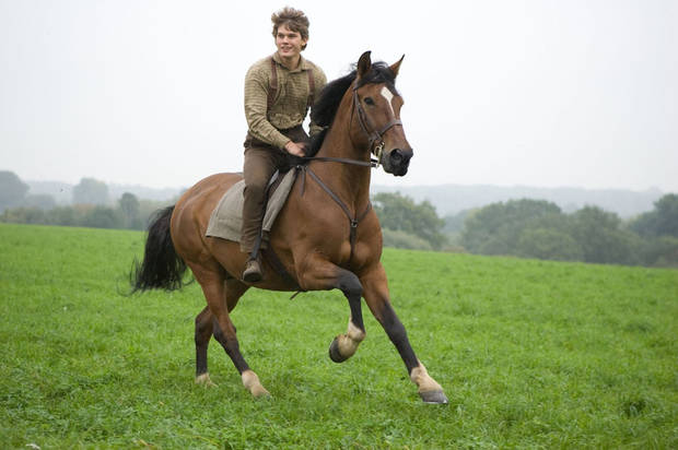 "MOVIE: ""WAR HORSE""..DM-AC-25226..Albert Narracott (Jeremy Irvine) joyfully rides atop his beloved horse, Joey in DreamWorks Pictures' ""War Horse"", director Steven Spielberg's epic adventure and an unforgettable odyssey through courage, friendship, discovery and wonder...Ph: Andrew Cooper, SMPSP..©DreamWorks II Distribution Co., LLC.  All Rights Reserved."