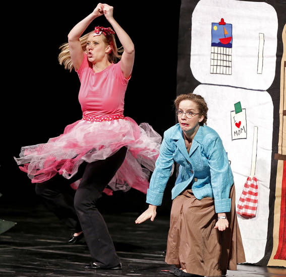 "Fumbelina, portrayed by Kristin Fitzgerald, left, narrowly avoids a collision with her mother, played by Suzanne Stanley, in a Cimarron Opera Company performance of ""Fumbelina"" Thursday for Norman third-graders. PHOTO BY STEVE SISNEY, THE OKLAHOMAN <strong>STEVE SISNEY</strong>"