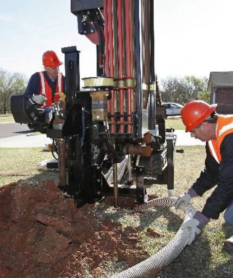 Workers drill a geothermal well at a home in Oklahoma City�s Hope Crossing subdivision in April 2011. The system was installed as part of an ongoiong research project to determine if geothermal technology can be used more cost effectively. Photo by David McDaniel, The Oklahoman archives