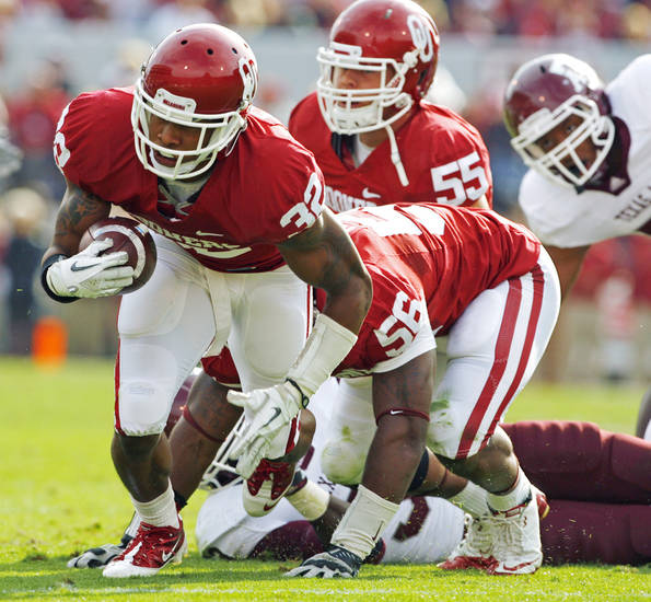 Oklahoma&#039;s Jamell Fleming (32) comes up with a ball pulled from Christine Michael (33) during the first half of the college football game between the Texas A&amp;M Aggies and the University of Oklahoma Sooners (OU) at Gaylord Family-Oklahoma Memorial Stadium on Saturday, Nov. 5, 2011, in Norman, Okla. Photo by Steve Sisney, The Oklahoman 