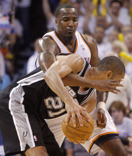 Oklahoma City's Kendrick Perkins (5) defends San Antonio's Tim Duncan (21) during Game 6 of the Western Conference Finals between the Oklahoma City Thunder and the San Antonio Spurs in the NBA playoffs at the Chesapeake Energy Arena in Oklahoma City, Wednesday, June 6, 2012. Oklahoma City won 107-99. Photo by Bryan Terry, The Oklahoman
