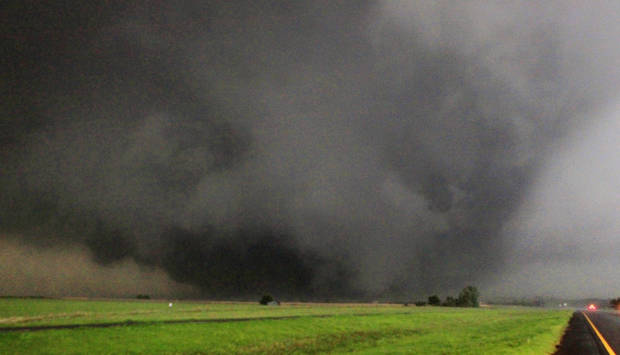 Left: A half-mile-wide tornado moves north in Canadian County toward Piedmont on May 24, 2011.  PHOTO BY PAUL B. SOUTHERLAND, THE OKLAHOMAN ARCHIVEs