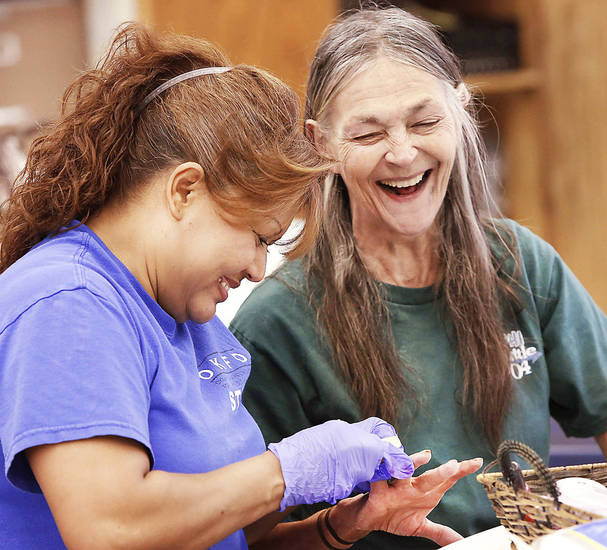 Rosa Chacon puts a smile on client Gigi Cherry's face with a generous portion of  personal attention, filing and polishing her fingernails at the Oklahoma Foundation for the Disabled.    Photo by Jim Beckel, The Oklahoman <strong>Jim Beckel - THE OKLAHOMAN</strong>