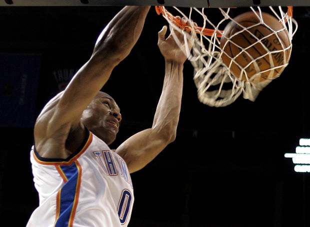 Oklahoma City Thunder's Russell Westbrook dunks unopposed against the Phoenix Suns in the first quarter of a preseason NBA basketball game in Oklahoma City, Monday, Oct. 12, 2009. (AP Photo/Sue Ogrocki) ORG XMIT: OKSO106