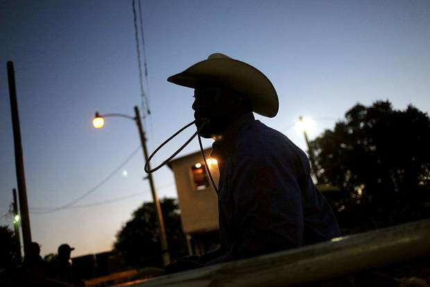 The sun sets behind a calf roper during the Annual Spring Jam Spencer Rodeo in Spencer, Oklahoma on Saturday, May 14, 2011. Photo by John Clanton, The Oklahoman