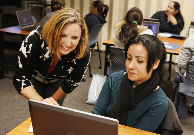 ICC assistant director Judy Smith helps Oklahoma City Family Literacy Program student Carmen Lopez, of Oklahoma City, Friday during a class on Photoshop at the Oklahoma City University Intergenerational Computer Center in Oklahoma City. Photo by Paul B. Southerland, The Oklahoman <strong>PAUL B. SOUTHERLAND - PAUL B. SOUTHERLAND</strong>