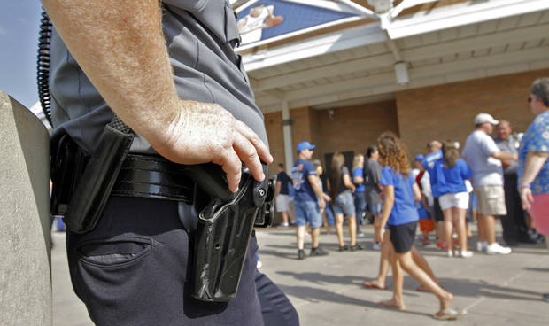 An Oklahoma City Police officer stands on patrol in Thunder Alley during Game 2 of the NBA Finals between the Oklahoma City Thunder and the Miami Heat at Chesapeake Energy Arena in Oklahoma City, Thursday, June 14, 2012. Photo by Chris Landsberger, The Oklahoman