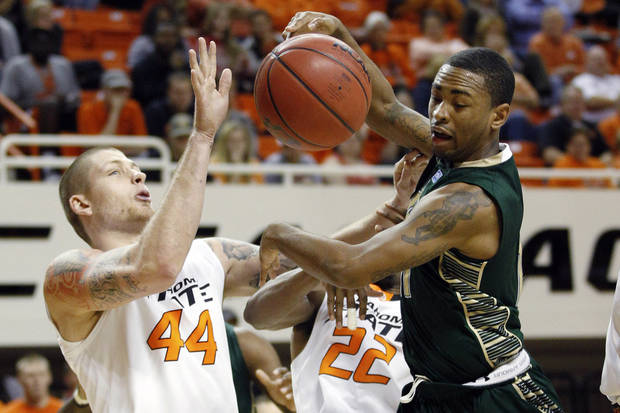 South Florida&#039;s Anthony Collins, right, loses control of the ball in front of Oklahoma State forward Philip Jurick (44) and guard Markel Brown (22) in the second half of an NCAA college basketball game in Stillwater, Okla., Wednesday, Dec. 5, 2012. Oklahoma State won 61-49. (AP Photo/Sue Ogrocki)