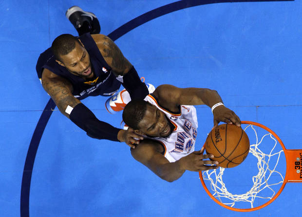 Oklahoma City's Kevin Durant (35) dunks as Memphis' Tony Allen (9) defends during Game 1 in the first round of the NBA playoffs between the Oklahoma City Thunder and the Memphis Grizzlies at Chesapeake Energy Arena in Oklahoma City, Saturday, April 19, 2014. Photo by Sarah Phipps, The Oklahoman