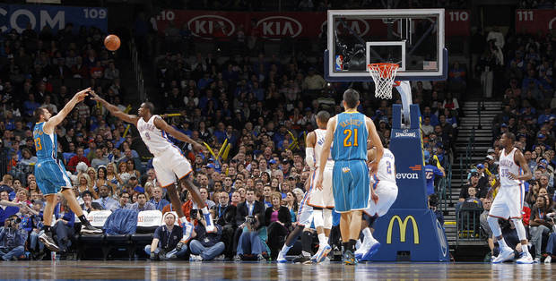 New Orleans Hornets' Ryan Anderson (33) shoots over Oklahoma City Thunder's Serge Ibaka (9) during the NBA basketball game between the Oklahoma CIty Thunder and the New Orleans Hornets at the Chesapeake Energy Arena on Wednesday, Dec. 12, 2012, in Oklahoma City, Okla.   Photo by Chris Landsberger, The Oklahoman