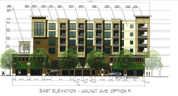 The two existing 1930s era service stations will be incorporated into a retail facade that will face Walnut Avenue as part of the second phase of the Maywood Apartments at NE 4 and Walnut.