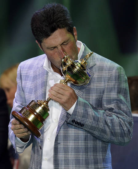 European team captain Jose Maria Olazabal kisses the trophy at the closing ceremony of the Ryder Cup PGA golf tournament Sunday, Sept. 30, 2012, at the Medinah Country Club in Medinah, Ill. (AP Photo/David J. Phillip)  ORG XMIT: PGA248