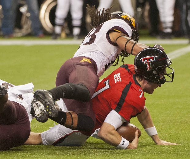 Texas Tech quarterback Seth Doege (7) dives into the end zone under Minnesota's Michael Carter for a touchdown during the second quarter of the Meineke Car Care Bowl NCAA college football game, Friday, Dec. 28, 2012, in Houston. (AP Photo/Dave Einsel)